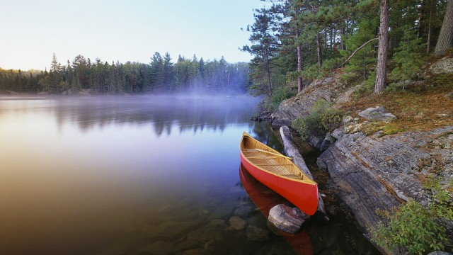 Canoe On A Misty Lake Canada